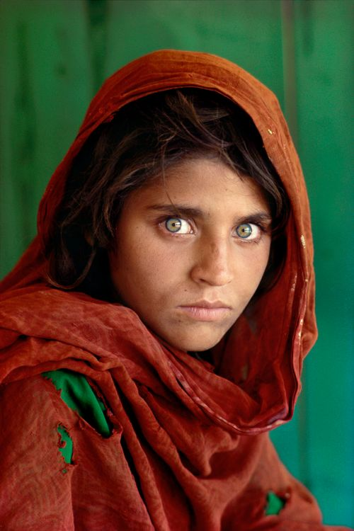 Afghan Girl is a 1984 photographic portrait of Sharbat Gula, also known as Sharbat Bibi, taken by photojournalist Steve McCurry. It appeared on the June 1985 cover of National Geographic. The image is of an adolescent girl with green eyes in a red headscarf looking intensely at the camera.