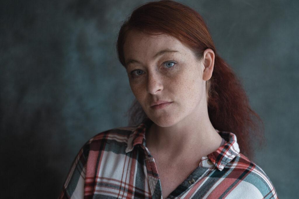 Headshot of female redhead.